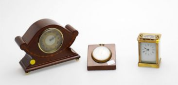 A small French lacquered brass carriage timepiece