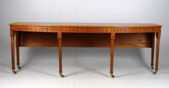 A modern mahogany long writing table