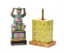 A Chinese Export 'Famille Rose' figural pricket-stick