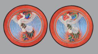 A pair of Chinese red silk circular panels