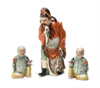 Three Chinese famille rose porcelain figures