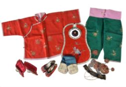 A group of Chinese child's clothes and shoes