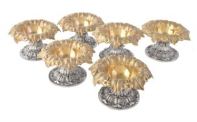 A set of six George IV silver parcel gilt salt cellars by Rebecca Emes & Edward Barnard I