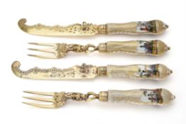 A set of six 19th century German silver gilt and Dresden porcelain dessert knives and forks