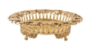 A George IV silver gilt circular dessert basket by William Eley & William Fearn