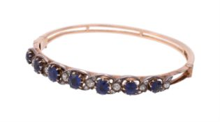A late Victorian and later sapphire and diamond hinged bangle
