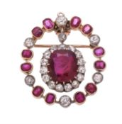 A late Victorian and later ruby and diamond brooch/pendant