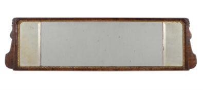 A George II walnut and parcel gilt wall mirror