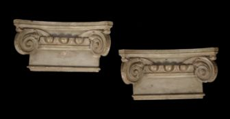 A pair of painted plaster Ionic order capitals