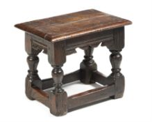 A rare Charles I oak child's joint stool