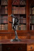 A large Italian patinated bronze model of Narcissus