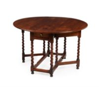 A William & Mary solid cedar gateleg dining table