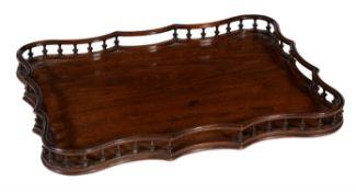 A George III mahogany serpentine tray