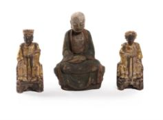 A pair of Chinese carved wood figures of dignitaries and another of a seated Lohan