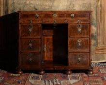 A William & Mary walnut and feather banded kneehole desk