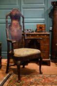 A George II walnut Master's armchair