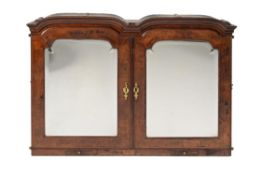 A George I walnut cabinet