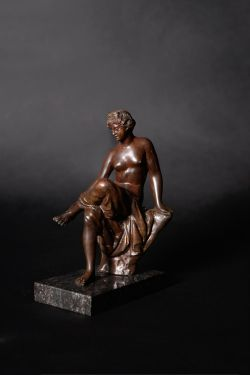 A fine North Italian patinated bronze model of a seated nymph