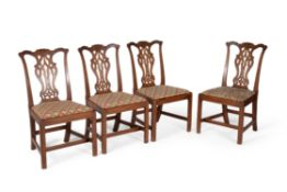 A set of four George III mahogany side chairs
