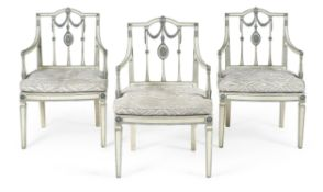 A set of three painted and parcel gilt open armchairs, circa 1790 and later re-painted