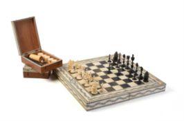 Y A fine Vizagapatam ivory, horn, ebony and sandalwood folding games board