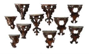 A companion set of ten unusual carved walnut miniature wall brackets