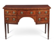 A George III mahogany and inlaid bowfront sideboard