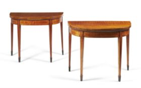A pair of George III figured mahogany and crossbanded card tables