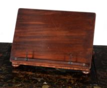 A George IV mahogany table top book rest, circa 1825, in the manner of Gillows