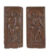 A pair of Flemish sculpted oak allegorical panels