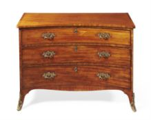 A George III mahogany concave fronted chest of drawers