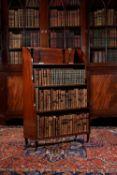 A Regency mahogany and ebony 'waterfall' bookcase