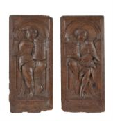 A pair of Flemish sculpted oak allegorical panels