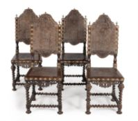 A set of four Iberian exotic hardwood and embossed leather upholstered chairs