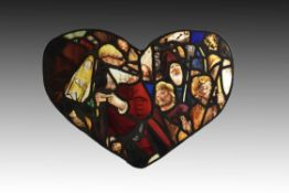 An unusual composite stained glass panel with portrait heads