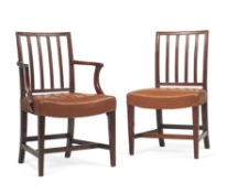 A set of fourteen George III mahogany and leather upholstered dining chairs