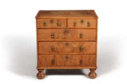 A William & Mary walnut and parquetry chest of drawers