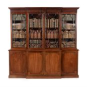 A mahogany breakfront library bookcase, in George III style