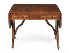 Y A Regency rosewood, inlaid and brass mounted sofa table