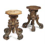 A pair of Continental walnut and parcel gilt quadrupartite low pedestals