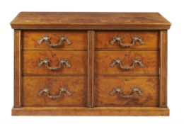 A George IV burr oak and gilt metal mounted chest of drawers