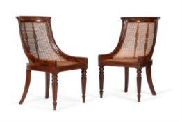 A pair of Regency mahogany library bergeres