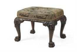 An Irish carved mahogany stool, in George II style, 19th century