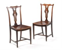 A pair of unusual George III fruitwood side chairs