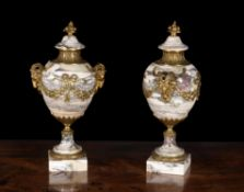 A pair of Breche Violette and gilt metal mounted ornamental urns in Louis XVI style