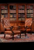 A pair of William IV mahogany and leather upholstered armchairs