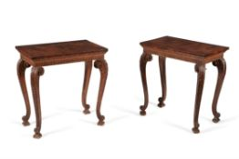A matched pair of walnut and carved pine side tables