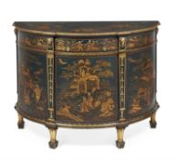 A dark green painted and gilt chinoiserie decorated demi-lune commode