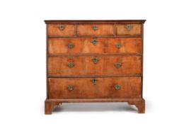 A George I walnut and crossbanded chest of drawers