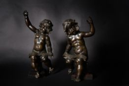 After Ferdinando Tacca, a pair of Italian patinated bronze models of musician putti